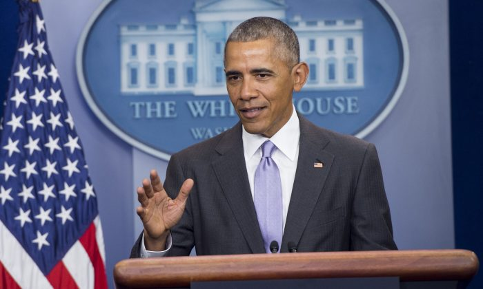 US President Barack Obama speaks during a surprise appearance at White House Press Secretary Josh Earnest's last daily press briefing  (SAUL LOEB/AFP/Getty Images)