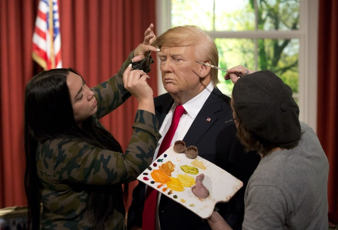 Employees put the finishing touches of a waxwork model of US President-elect Donald Trump at Madame Tussaud's in London on Jan. 18, 2017. Trump will be inaugurated Friday as the 45th president of the United States. (Isabel Infantes/AFP/Getty Images)
