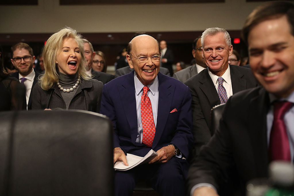Wilbur Ross, (C) with his wife, Hilary Geary Ross, as he waits to be introduced by Sen. Marco Rubio (R-FL) (far R) to testify at his confirmation hearing in front of the Senate Commerce Committee on Capitol Hill in Washington, DC. on Jan. 18, 2017. (Joe Raedle/Getty Images)