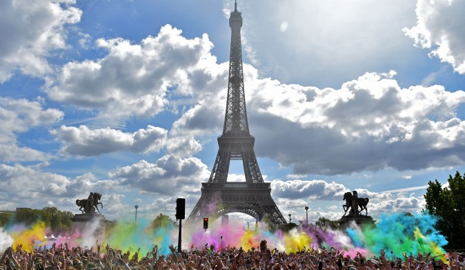 People take part in the Color Run 2017 's edition in front of the Eiffel Tower in Paris on April 16, 2017. The Color Run is a 5 kilometers paint race without winners nor prizes, where runners are showered with colored powder at stations along the run. (CHRISTOPHE ARCHAMBAULT/AFP/Getty Images)