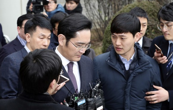 Lee Jae-yong, a vice chairman of Samsung Electronics Co. is questioned by reporters as he leaves after attending the hearing at the Seoul Central District Court in Seoul, South Korea, on Jan. 18, 2017. (AP Photo/Lee Jin-man)