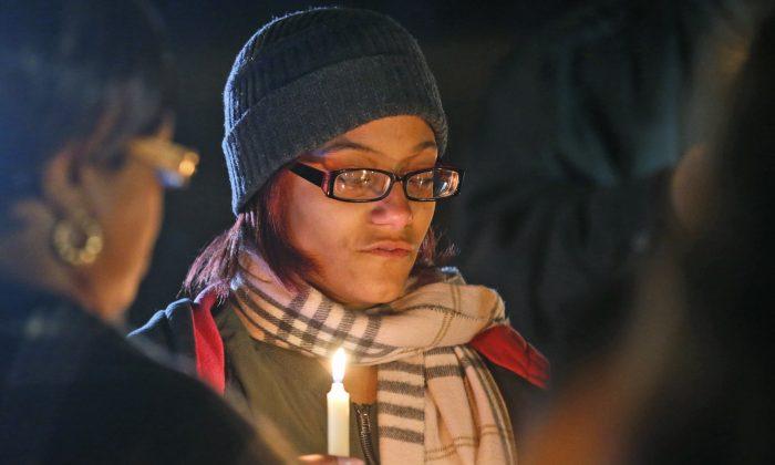 Death penalty opponents hold a candlelight vigil outside the Greensville Correctional Center in Jarratt, Va., on Jan. 18, 2017. (AP Photo/Steve Helber)