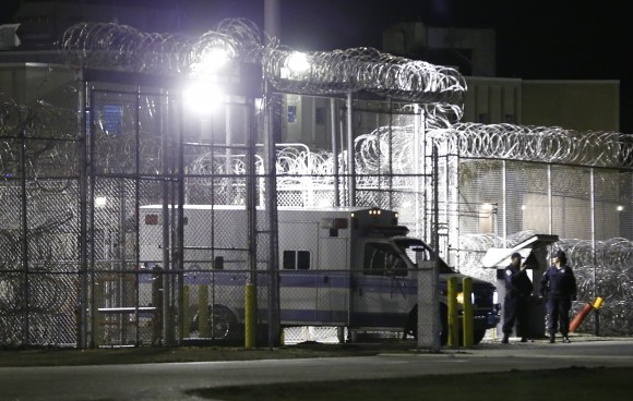 An ambulance exits the secure area after the execution of Ricky Gray at the Greensville Correctional Center in Jarratt, Va., on Jan. 18, 2017. (AP Photo/Steve Helber)