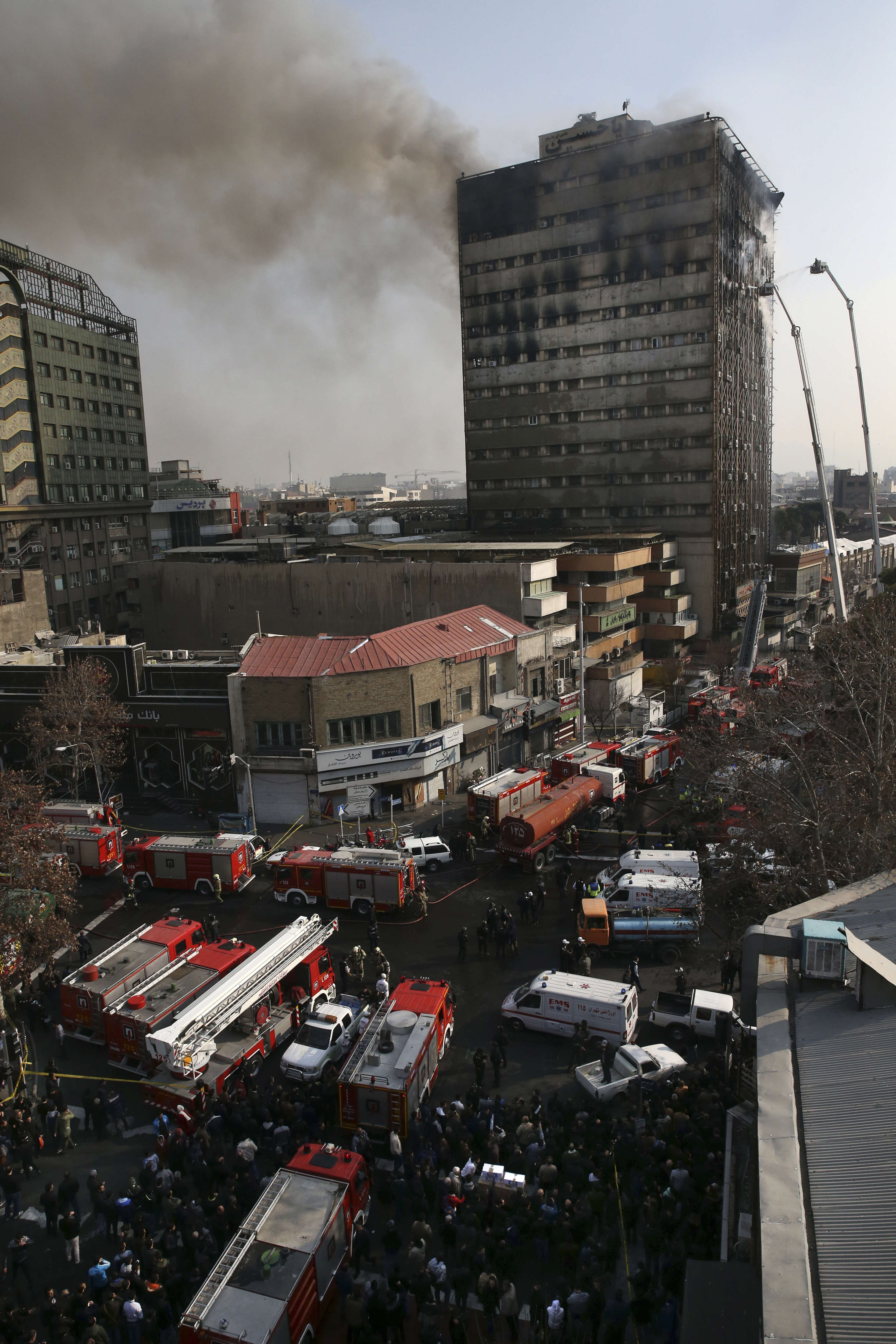 Smoke rises up from the Plasco building where firefighters work to extinguish fire in central Tehran, Iran on Jan. 19, 2017. (AP Photo/Vahid Salemi)