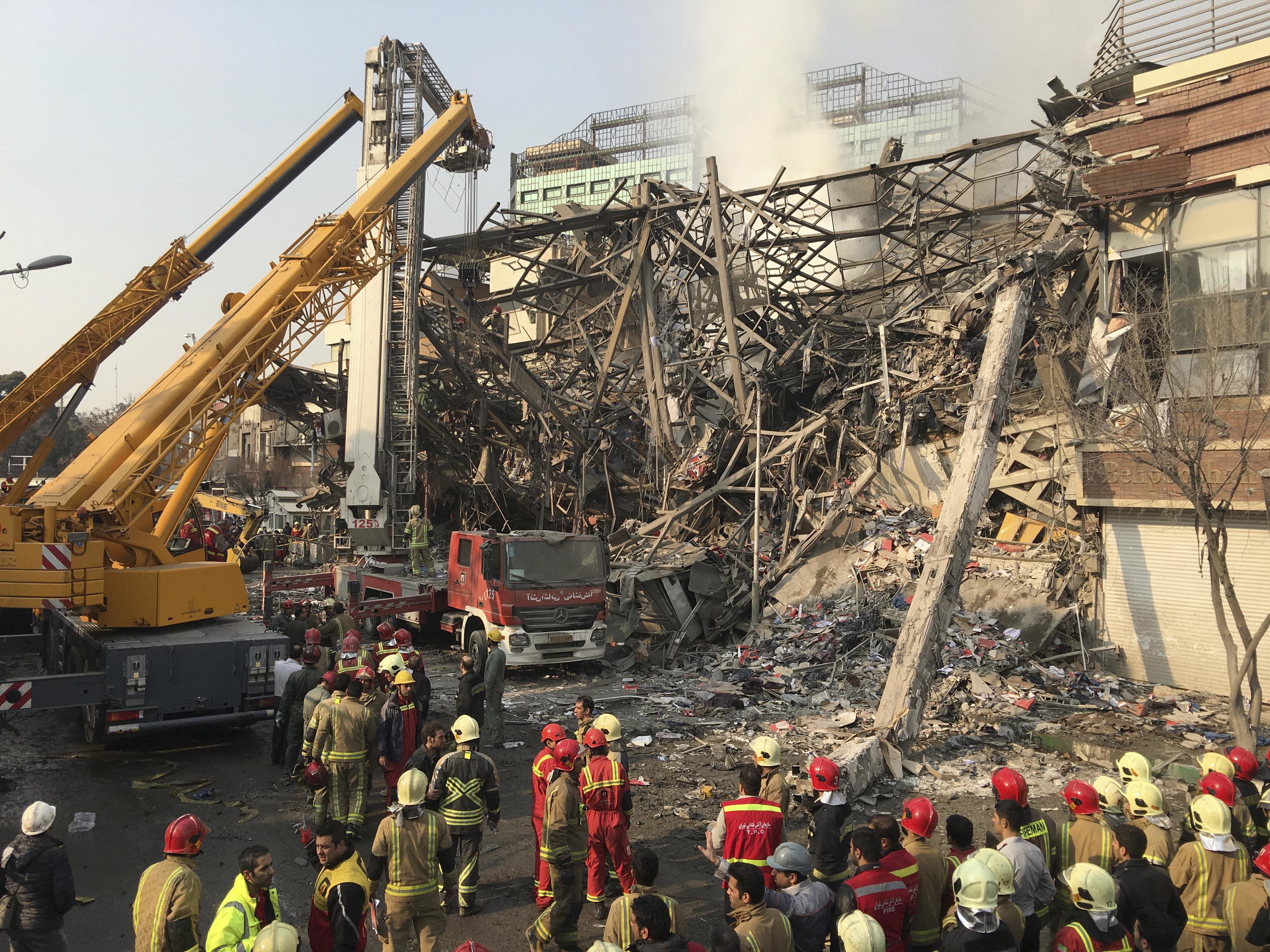 Iranian firefighters work at the scene of the collapsed Plasco building after being engulfed by a fire, in central Tehran, Iran on Jan. 19, 2017. (AP Photo/Ebrahim Noroozi)