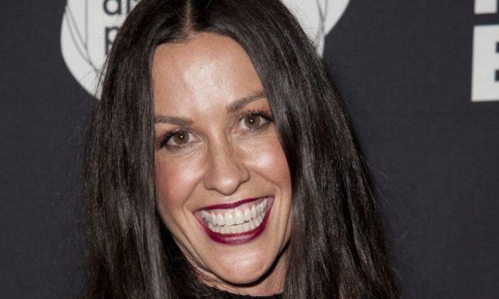 This June 20, 2014 file photo Alanis Morissette arrives at the 4th Annual Production Of The 24 Hour Plays After-Party in Santa Monica, Calif. Federal prosecutors say a business manager who embezzled more than $6.5 million from Morissette and other entertainment and sports figures has agreed to plead guilty. Jonathan Todd Schwartz agreed Wednesday, Jan. 18, 2017 to plead guilty in Los Angeles federal court to two felonies that carry a maximum of 23 years in federal prison. (Photo by Richard Shotwell/Invision/AP,File)