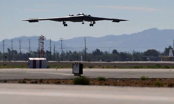 A B-2 Stealth Bomber comes in for a landing at the Palmdale Aircraft Integration Center of Excellence in Palmdale, CA., on July 17, 2014. (FREDERIC J. BROWN/AFP/Getty Images)