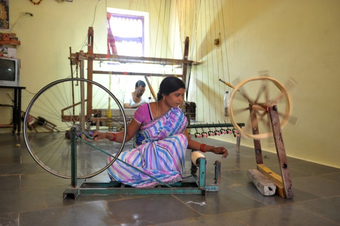 Vanam Pavani works on a charka, or spinning wheel, as she winds weft yarn in her household workshop in Koyalagudem village, in the southern state of Telangana, India, on Jan. 19, 2017. The weavers from the area are known to manufacture exclusive sarees with intricate and distinctive designs. (Noah Seelam/AFP/Getty Images)