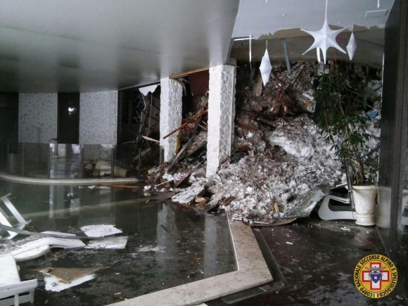 The interior of the Rigopiano Hotel is destroyed by an avalanche in Farindola, Italy, early Thursday, Jan. 19, 2017. Rescue workers on skis reached a four-star spa hotel buried by an avalanche in earthquake-stricken central Italy Thursday, reporting no signs of life as they searched for around 30 people believed trapped inside.  (Corpo Nazionale Soccorso Alpino e Speleologico/The National Alpine Cliff and Cave Rescue Corps (CNSAS) via AP)