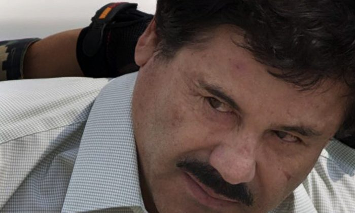 """Joaquin """"El Chapo"""" Guzman is escorted to a helicopter in handcuffs by Mexican navy marines at a navy hanger in Mexico City on Feb. 22, 2014. According to Mexico's Foreign Ministry, Guzman has been extradited to the United States on Jan. 19 2017. (AP Photo/Eduardo Verdugo, File)"""