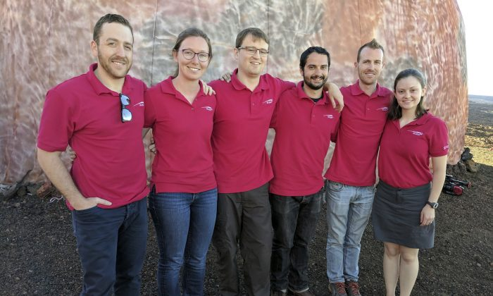 In this photo provided by the University of Hawaii, scientists Joshua Ehrlich, from left, Laura Lark, Sam Payler, Brian Ramos, Jay Bevington and Ansley Barnard, pose for a photo before they enter a geodesic dome called Hawaii Space Exploration Analog and Simulation, or HI-SEAS located 8,200 feet above sea level on Mauna Loa on the island of Hawaii, on Jan. 19, 2017. (University of Hawaii via AP)