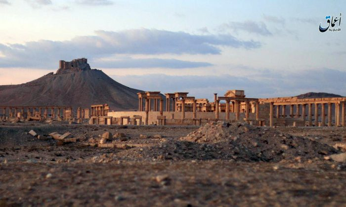 A general view of the ancient ruins of the city of Palmyra, in Homs province, Syria, with the Citadel of Palmyra in the background on Dec. 11, 2016. (Militant video via AP)