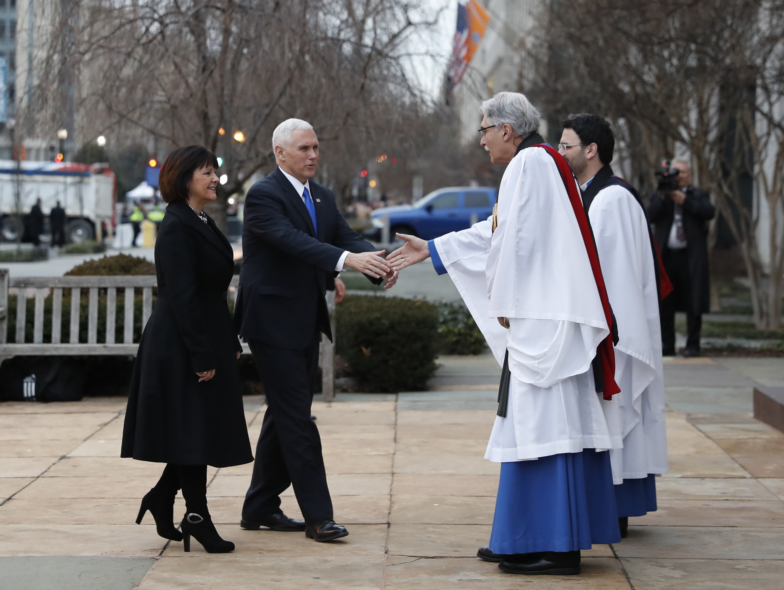 Rev. Luis Leon greets Vice President-elect Mike Pence and his wife Karen as they arrive for a church service at St. John's Episcopal Church across from the White House in Washington on Jan. 20, 2017, on Donald Trump's inauguration day. (AP Photo/Alex Brandon)