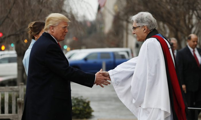 Rev Luis Leon greets President-elect Donald Trump and his wife Melania as they arrive for a church service at St. John's Episcopal Church across from the White House in Washington on Jan. 20, 2017, on Donald Trump's inauguration day. (AP Photo/Alex Brandon)