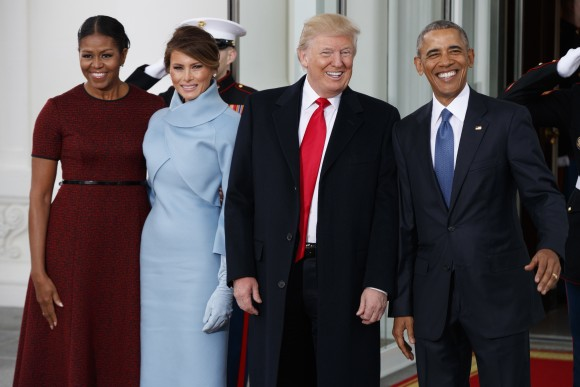 President Barack Obama, first lady Michelle Obama, President-elect Donald Trump and Melania Trump stand at the White House in Washington on Jan. 20, 2017. (AP Photo/Evan Vucci)