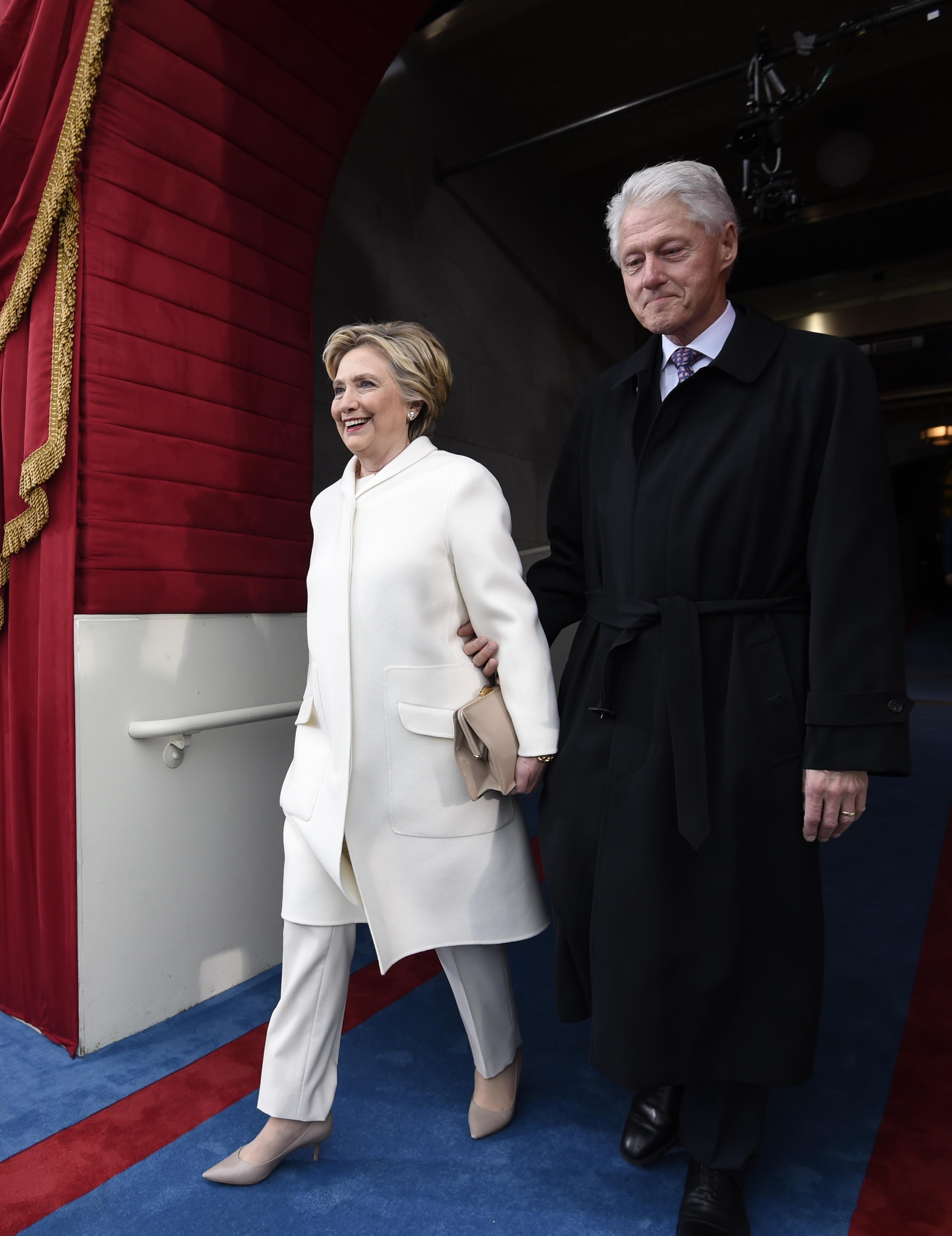Former President Bill Clinton and his wife Hillary Clinton arrive on Capitol Hill in Washington on Jan. 20, 2017. (Saul Loeb via AP, Pool)