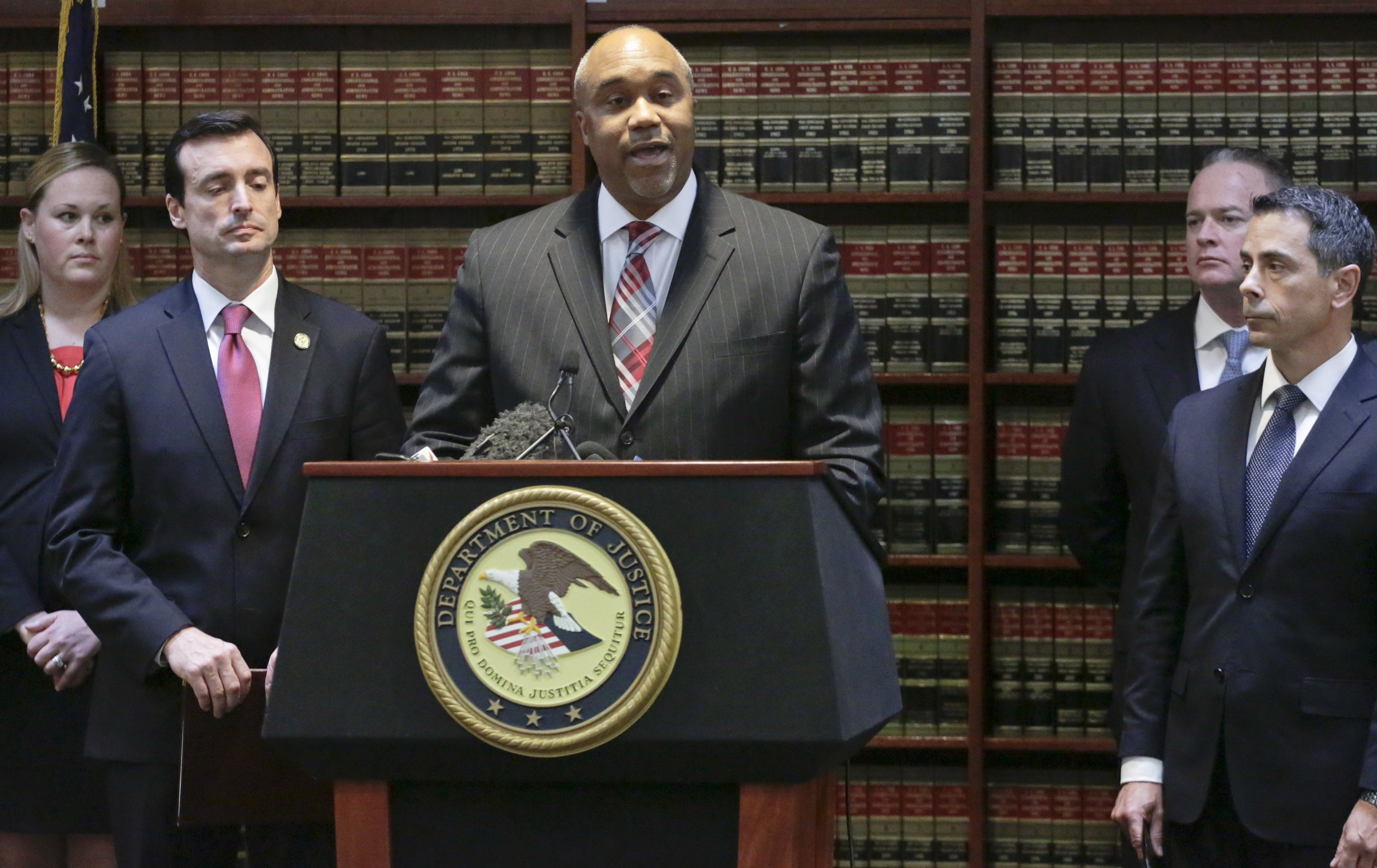 """U.S. attorney Robert Capers (C) during a news conference, announcing charges for Mexican drug kingpin Joaquin """"El Chapo"""" Guzman as the murderous architect of a three-decade-long web of violence, corruption and drug trafficking in the Brooklyn borough of New York on Jan. 20, 2017. (AP Photo/Mark Lennihan)"""