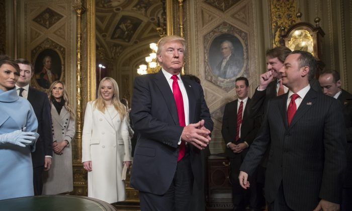 Then-President Donald Trump is seen after he formally signed his cabinet nominations into law, with advisers including White House counsel Don McGahn, leaves the President's Room of the Senate on Capitol Hill in Washington on Jan. 20, 2017. (J. Scott Applewhite/Pool/AP Photo)