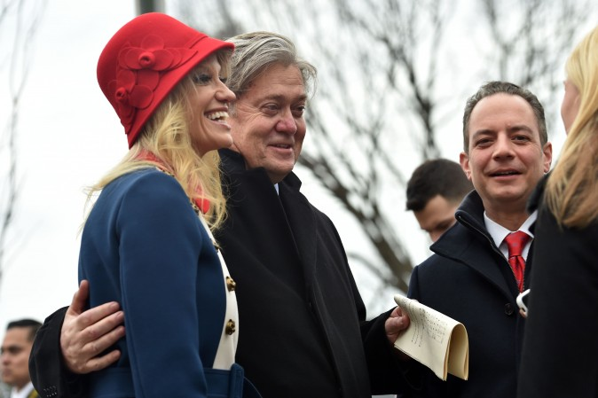 (L-R) Kellyanne Conway, Steve Bannon and Reince Priebus speak outside St. John's Episcopal Church before the inauguration of US President-elect Donald Trump on Jan. 20, 2017. (NICHOLAS KAMM/AFP/Getty Images)
