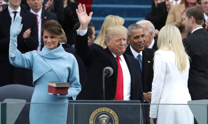 President Donald Trump and First Lady Melania Trump wave to the crowd as former president Barack Obama greets Tiffany Trump on the West Front of the U.S. Capitol in Washington, DC on Jan. 20, 2017. (Alex Wong/Getty Images)