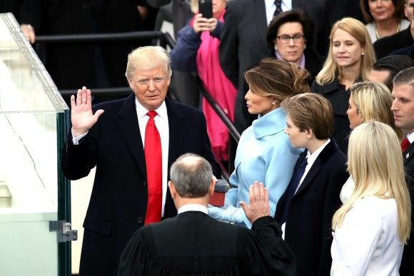 Supreme Court Justice John Roberts (2L) administers the oath of office to U.S. President Donald Trump (L) as his wife Melania Trump holds the Bible on the West Front of the U.S. Capitol on January 20, 2017 in Washington, DC. In today's inauguration ceremony Donald J. Trump becomes the 45th president of the United States. (Drew Angerer/Getty Images)