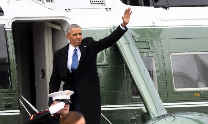 Former President Barack Obama waves as he boards a helicopter to depart the US Capitol after inauguration ceremonies for President Donald Trump at the US Capitol in Washington, DC, on Jan. 20, 2017. (JIM WATSON/AFP/Getty Images)