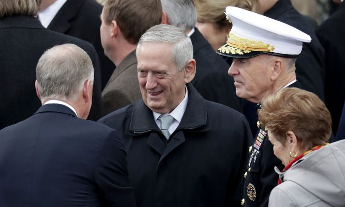 Donald Trump's Defense Secretary Gen. James Mattis (C) arrives on the West Front of the U.S. Capitol in Washington, DC. on Jan. 20, 2017. (Photo by Chip Somodevilla/Getty Images)