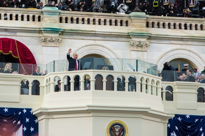 President Donald Trump waves after being sworn in as the 45th president of the United States during the 58th Presidential Inauguration at the U.S. Capitol in Washington, on Jan. 20, 2017. (Benjamin Chasteen/Epoch Times)