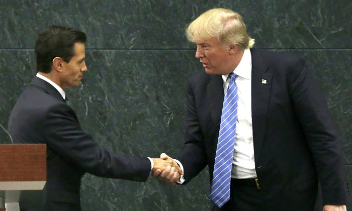 Mexico's President Enrique Pena Nieto (L) and Republican presidential nominee Donald Trump shake hands after a joint statement at Los Pinos, the presidential official residence, in Mexico City on Aug. 31, 2016. (AP Photo/Marco Ugarte, File)