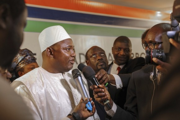 Adama Barrow, left, speaks to the media after he was sworn in as President of Gambia at Gambia's embassy in Dakar, Senegal on Jan 19, 2017. A new Gambian president has been sworn into office in neighboring Senegal, while Gambia's defeated longtime ruler refuses to step down from power, deepening a political crisis in the tiny West African country. (AP Photo)