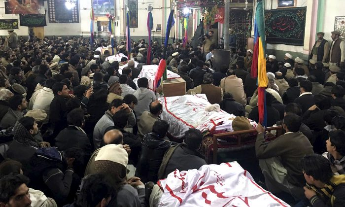 Pakistani Shiite Muslims attend the funeral prayer of the victims of bomb blast at a mosque in Parachinar, the capital of Pakistan's Kurram tribal region on Jan. 21, 2017. A bomb exploded in a market in a northwest tribal region that borders Afghanistan, killing more than 20 and wounding dozens. (AP Photo/Ali Murtaza)