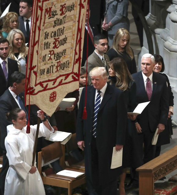 President Donald Trump, first lady Melania Trump and Vice President Mike Pence, second from right, and his wife Karen, right, attend a National Prayer Service at the National Cathedral, in Washington on Jan. 21, 2017. (AP Photo/Manuel Balce Ceneta)