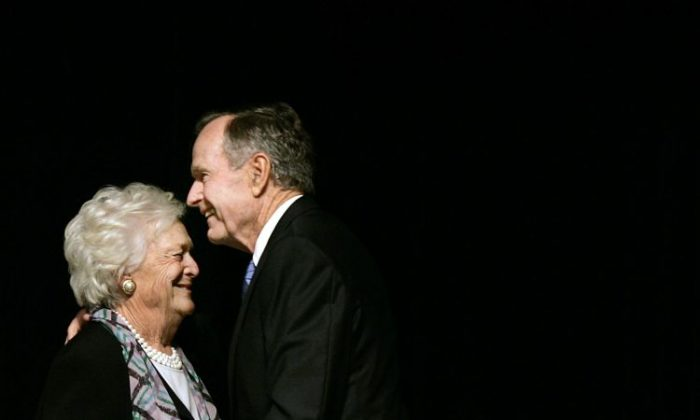 In this May 3, 2006 photo, former President George H.W. Bush embraces former first lady Barbara Bush after she introduced him at the Genesis Women's Shelter Mother's Day Luncheon in Dallas. The Bushes, who have had the longest marriage of any presidential couple in American history, were both hospitalized this week in Houston, where the former president is being treated for pneumonia and his wife for bronchitis. (AP Photo/Tony Gutierrez)