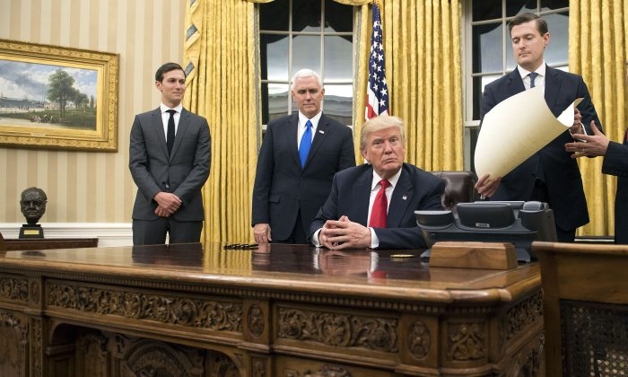 President Donald Trump prepares to sign a confirmation for Defense Secretary James Mattis in the Oval Office at the White House in Washington, D.C. on Jan. 20, 2017. (Kevin Dietsch - Pool/Getty Images)