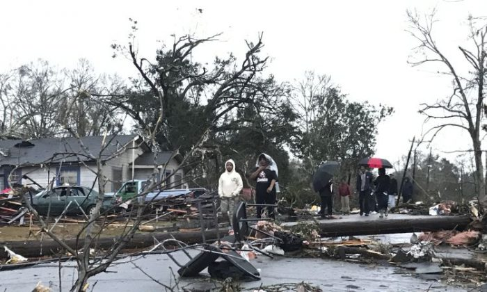 """Trees and debris cover the ground after a tornado tornado ripped through the Hattiesburg, Miss.,  area early Saturday, Jan. 21, 2017.  Mayor Johnny DuPree has signed an emergency declaration for the city, which reported """"significant injuries"""" and structural damage.  (Ryan Moore/WDAM-TV via AP)"""
