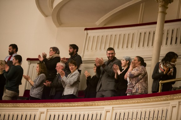 """Audience members give a standing ovation after """"Cantata Memoria"""" by Sir Karl Jenkins at Carnegie Hall, conducted by Jonathan Griffiths, in New York City on Jan. 15, 2017. (Samira Bouaou/Epoch Times)"""