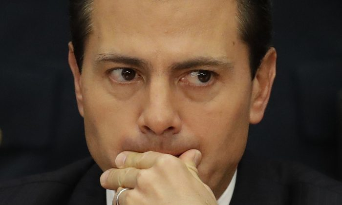 Mexico's President Enrique Pena Nieto during an event announcing an accord meant to strengthen the national economy and keep down household costs, in Mexico City. (AP Photo/Rebecca Blackwell)