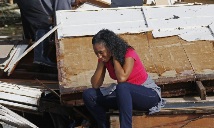 Shanise McMorris grieves on the slab of her Hattiesburg, Miss., home after an early tornado hit the city, on Jan. 21, 2017. (AP Photo/Rogelio V. Solis)
