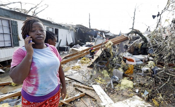 Lanada Miller stands before the remains of her trailer home being ripped apart, while leaving two other trailers with exterior damage in in Hattiesburg, Miss., on Jan. 21, 2017. (AP Photo/Rogelio V. Solis)