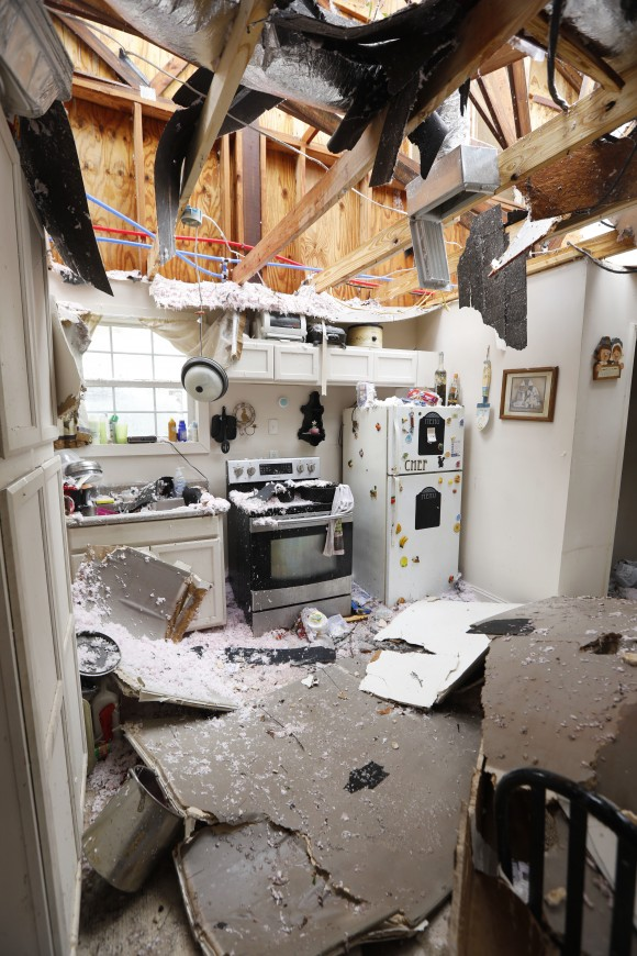 An open kitchen littered with roofing and ceiling debris show the strength of the tornado that hit this south Mississippi community in Hattiesburg, Miss., on Jan. 21, 2017. (AP Photo/Rogelio V. Solis)