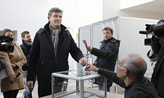 Former Economy minister Arnaud Montebourg during the first round of the French left's presidential primary election, in Montret, eastern France on Jan. 22, 2017. (AP Photo/Laurent Cipriani)