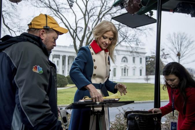 President Donald Trump's adviser Kellyanne Conway gets ready to go on television outside the White House, Sunday, Jan. 22, 2017, in Washington. (AP Photo/Manuel Balce Ceneta)