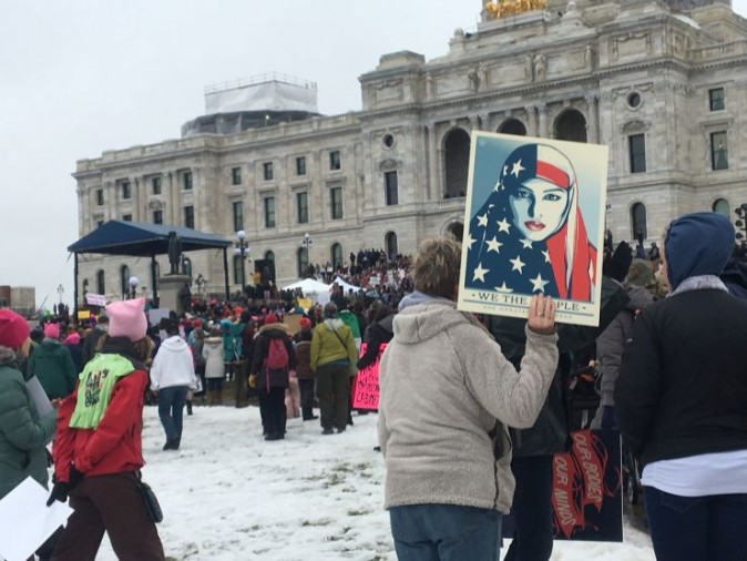 A protester holds sign at Minnesota Women's March in front of state Capitol in St. Paul, Minn., on Saturday, Jan. 21, 2017.  The march was held in in conjunction with with similar events taking place around the nation following the inauguration of President Donald Trump. (AP Photo/Jeff Baenen)