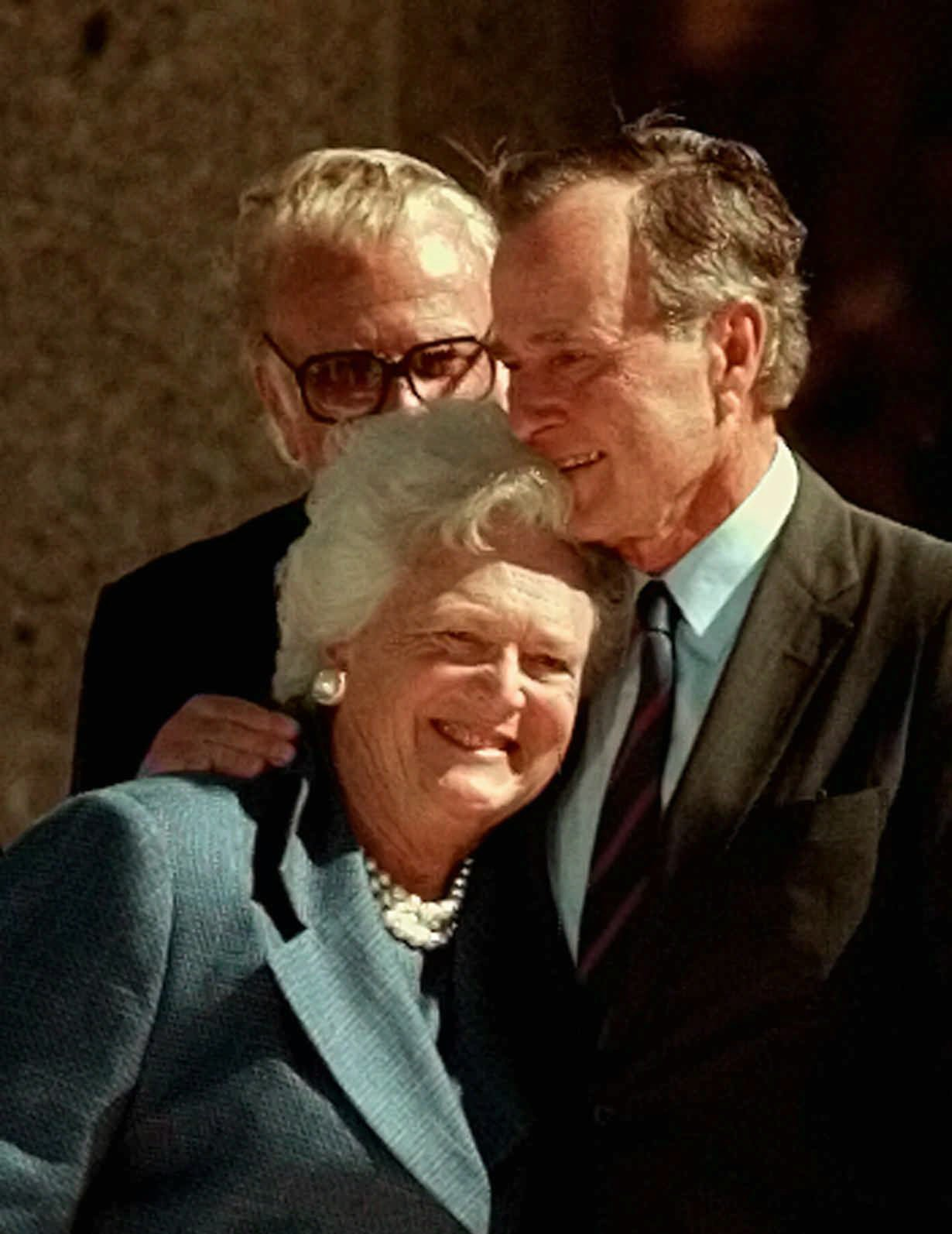 Former President George H.W. Bush hugs his wife, Barbara, after speaking at the dedication of the George Bush Presidential Library in College Station, TX., on Nov. 6, 1997. (AP Photo/Pat Sullivan)
