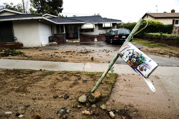 Mud and debris from the previous storm have damaged a mailbox along Melcanyon Road below the recent Fish fire burn area in Duarte on Sunday morning, Jan. 22, 2017. Authorities issued mandatory evacuation orders for homes surround Valley View Park and Valley View Elementary School. (Watchara Phomicinda/Los Angeles Daily News via AP)