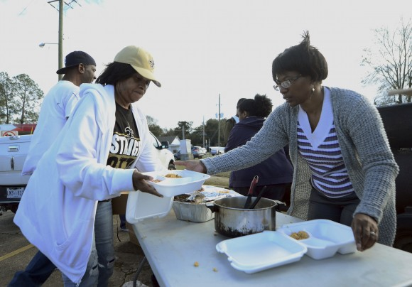 Hattiesburg, Miss., volunteers Brenda Dillion and Vanessa Molden put together boxes of food to give out to tornado victims, law enforcement and others in need of food after Saturday's tornado in Hattiesburg on Sunday, Jan. 22, 2017. The enormous system put millions of people in the South on edge during a weekend of violent weather that left crumpled trailer homes, downed trees and other damage in the hardest-hit communities from Mississippi to Georgia. (Susan Broadbridge/Hattiesburg American via AP)