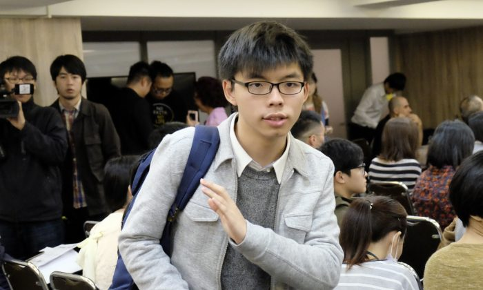 """Hong Kong activist-politician Joshua Wong attends a political forum hosted by Taiwan's grassroot New Power Party (NPP) in Taipei on January 8, 2017. A new documentary film about Wong, """"Joshua: Teenager vs Superpower,"""" premiered at the Sundance Festival on Jan. 20, 2017. (Sam Yeh/AFP/Getty Images)"""