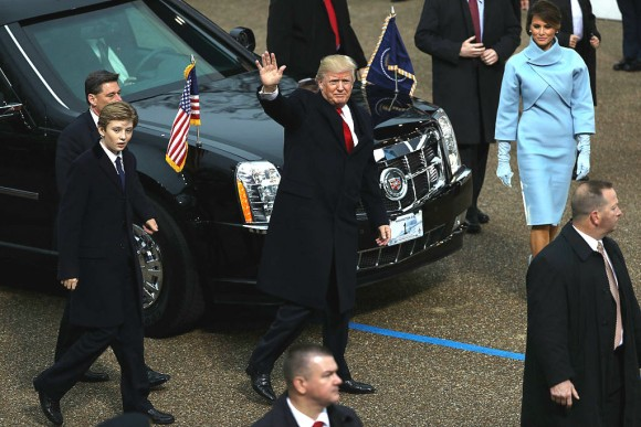 U.S. President Donald Trump (C) waves to supporters as he walks the parade route with first lady Melania Trump (R) and son Barron Trump (L) during the Inaugural Parade in Washington, DC., on Jan. 20, 2017. (Patrick Smith/Getty Images)