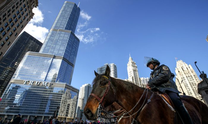 Police keep an eye on protesters outside of Trump Tower on Jan. 21, 2017 in Chicago, Illinois. Tens of thousands of demonstrators took to the streets in protest after the inauguration of President Donald Trump. (John Gress/Getty Images)