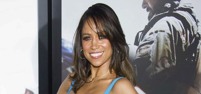 """In this Dec. 15, 2014 file photo, Stacey Dash attends the """"American Sniper"""" premiere in New York.  Fox News Channel is cutting ties with some of its paid contributors, including former """"Clueless"""" actress Stacey Dash and veteran conservative columnist George Will. The network said Monday, Jan. 23, 2017, that it had also declined to renew the contracts of political strategist Ed Rollins and columnist Cal Thomas. (Photo by Charles Sykes/Invision/AP, File)"""